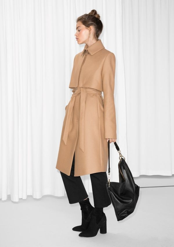"""It's <a href=""""https://www.stories.com/us/Ready-to-wear/Outerwear/Wool_Trenchcoat/582949-0167979007.2"""" target=""""_blank"""">everyth"""