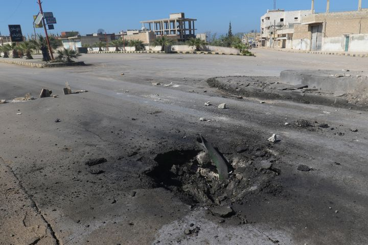 A crater is seen at the site of an airstrike, after what rescue workers described as a suspected gas attack in the town of Kh