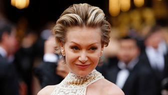 Actress Portia de Rossi arrives at the 86th Academy Awards in Hollywood, California March 2, 2014.  REUTERS/Mike Blake (UNITED STATES - TAGS: ENTERTAINMENT) (OSCARS-ARRIVALS)