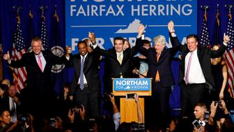Virginia Governor Elect Ralph Northam (C) celebrates with, left to right, Gov. Terry McAuliffe, Lt. Governor Elect Justin Fairfax, Attorney General Mark Herring and Sen. Mark Warner (D-VA), at his election night rally on the campus of George Mason University in Fairfax, Virginia, November 7, 2017. REUTERS/Aaron P. Bernstein     TPX IMAGES OF THE DAY