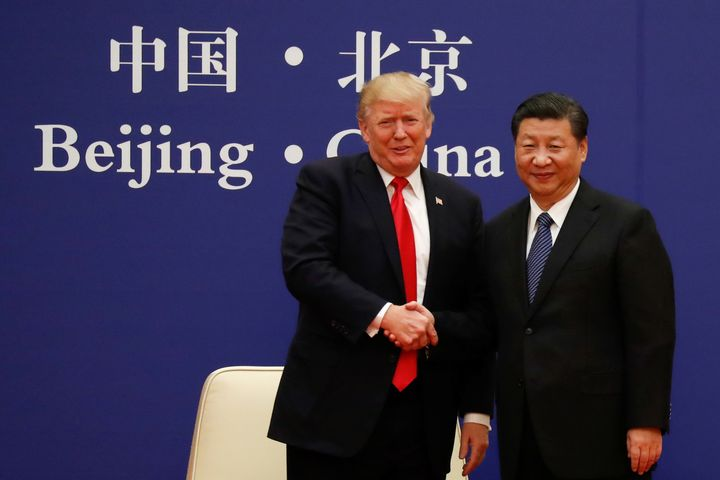 President Donald Trump and China's President Xi Jinping met with business leaders at the Great Hall of the People in Beijing