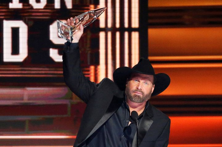 Country music legend Garth Brooks won the Entertainer of the Year award for a second straight year.