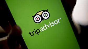 The TripAdvisor Inc. application is displyed on an Apple Inc. iPhone for a photograph in Washington, D.C., U.S., on Friday, May 5, 2017. TripAdvisor is scheduled to released earnings figures on May 9. Photographer: Andrew Harrer/Bloomberg via Getty Images