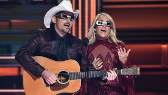 NASHVILLE, TN - NOVEMBER 08:  Co-hosts Brad Paisley and Carrie Underwood speak onstage at the 51st annual CMA Awards at the Bridgestone Arena on November 8, 2017 in Nashville, Tennessee.  (Photo by John Shearer/WireImage)