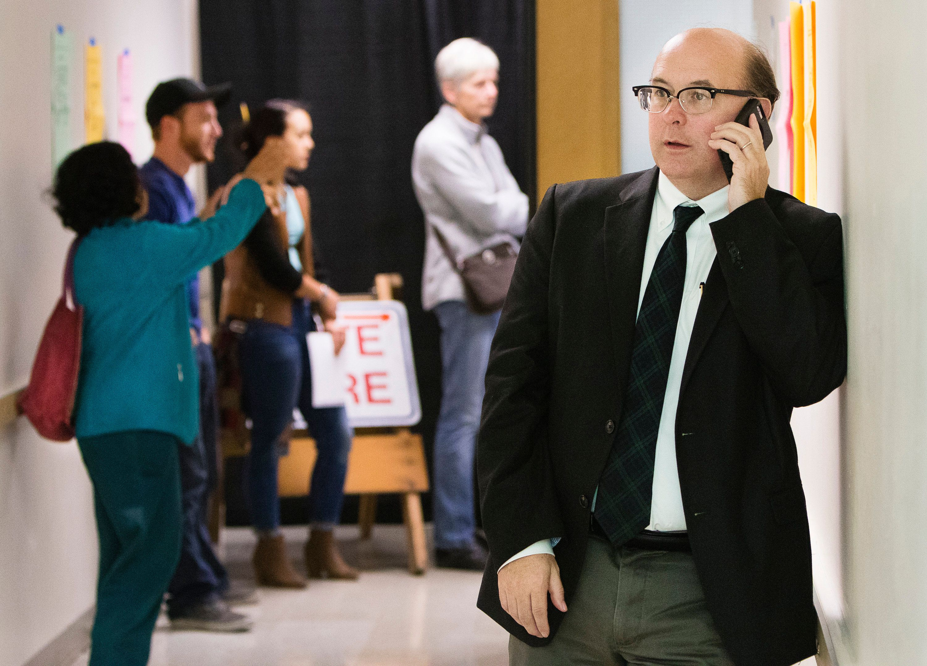 PORTLAND, ME - NOVEMBER 8: Maine Secretary of State Matthew Dunlap fields a phone call during one of several election day stops, to see how the polling process is going, at the Merrill Auditorioun Rehearsal Hall voting location in Portland on Tuesday, November 8, 2016. (Photo by Carl D. Walsh/Portland Press Herald via Getty Images)