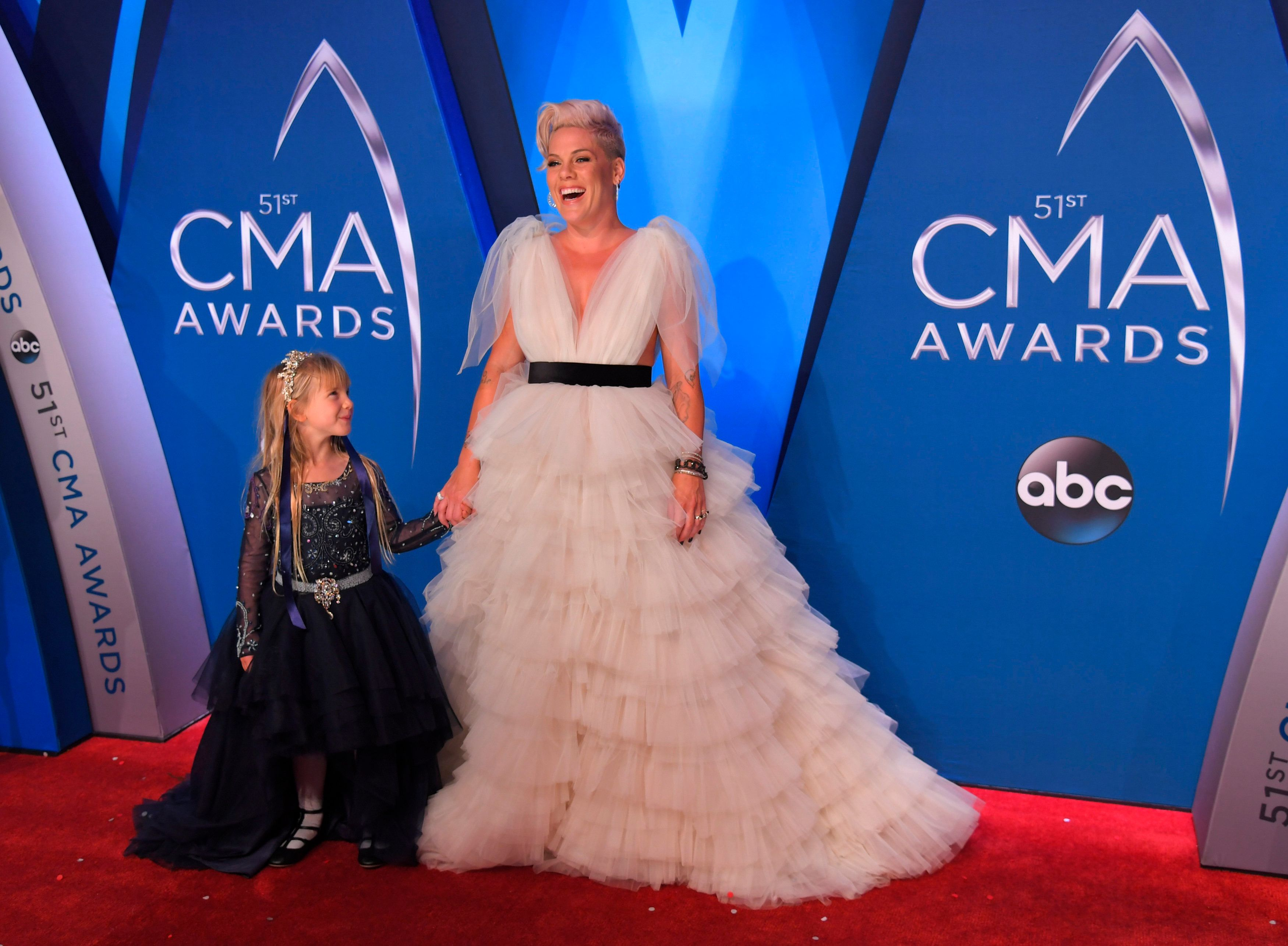 """Pink attended the CMA Awards to promote her new album, """"Beautiful Trauma"""" and perform her song """"Barbies"""" as the featured pop-star guest."""