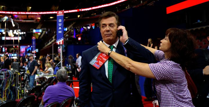Kathleen Manafort tries to put a credential on her husband, Paul Manafort, at the Republican National Convention in Cleveland