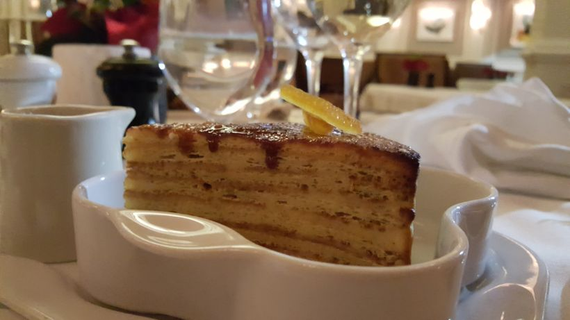 Gateau de Crepe with Suzette Sauce and orange coffee sorbet.