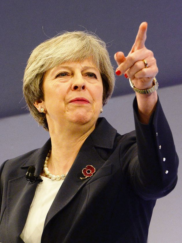 Theresa May says she is committed to closing the gender pay