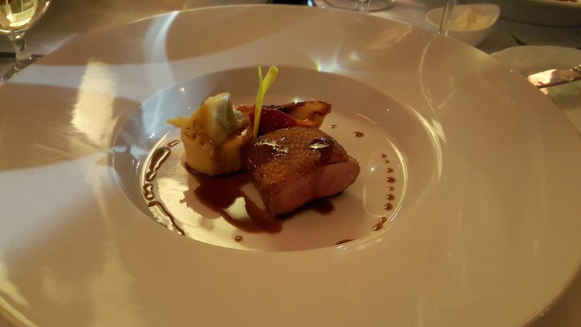 Roast duck breast with agnolotti, roast local peach, seven spice jus at Little Rock's Capital Hotel