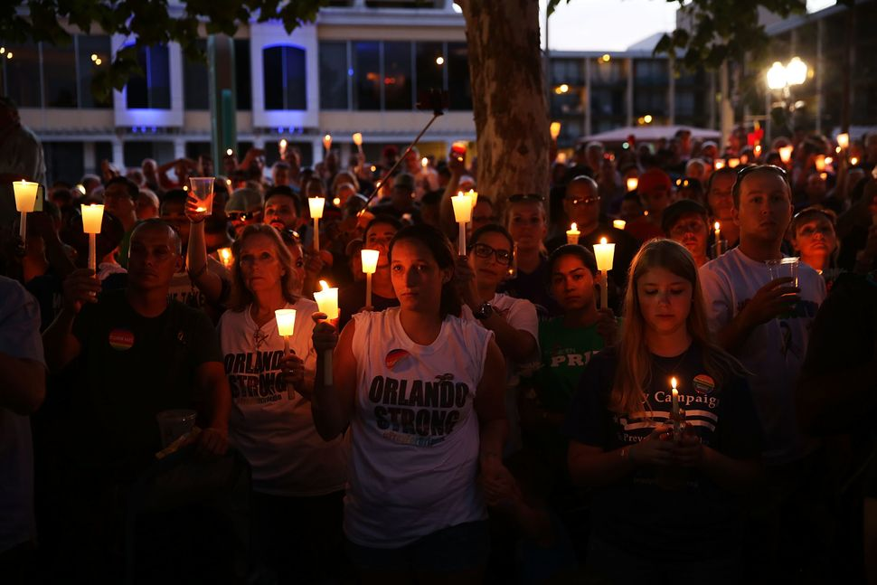 People attend a memorial service on June 19, 2016, in Orlando, Florida.