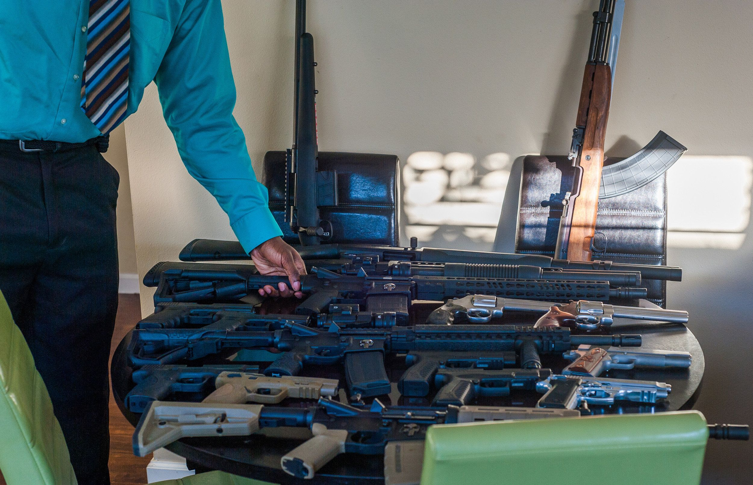 LeFlore and some of his gun collection.