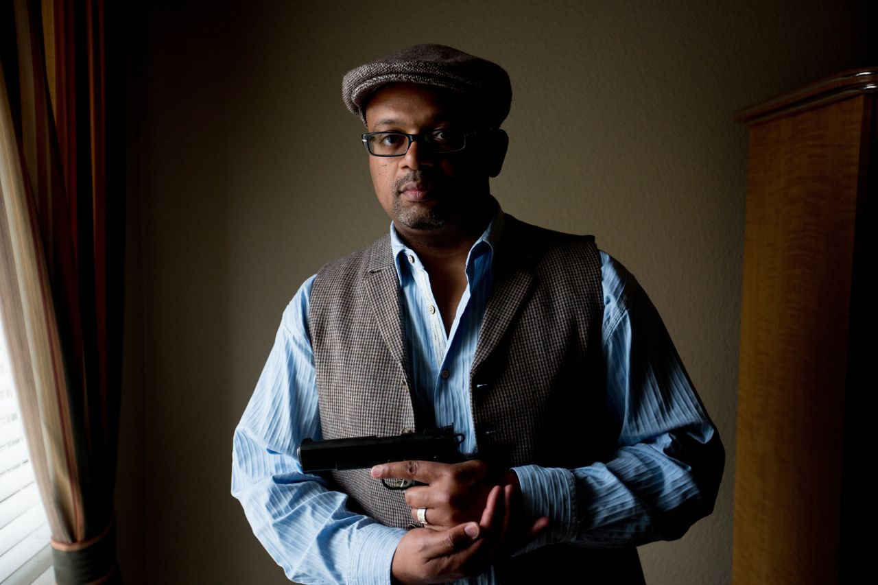 Rodney Jackson holds one of his guns at his home in Plano, Texas.