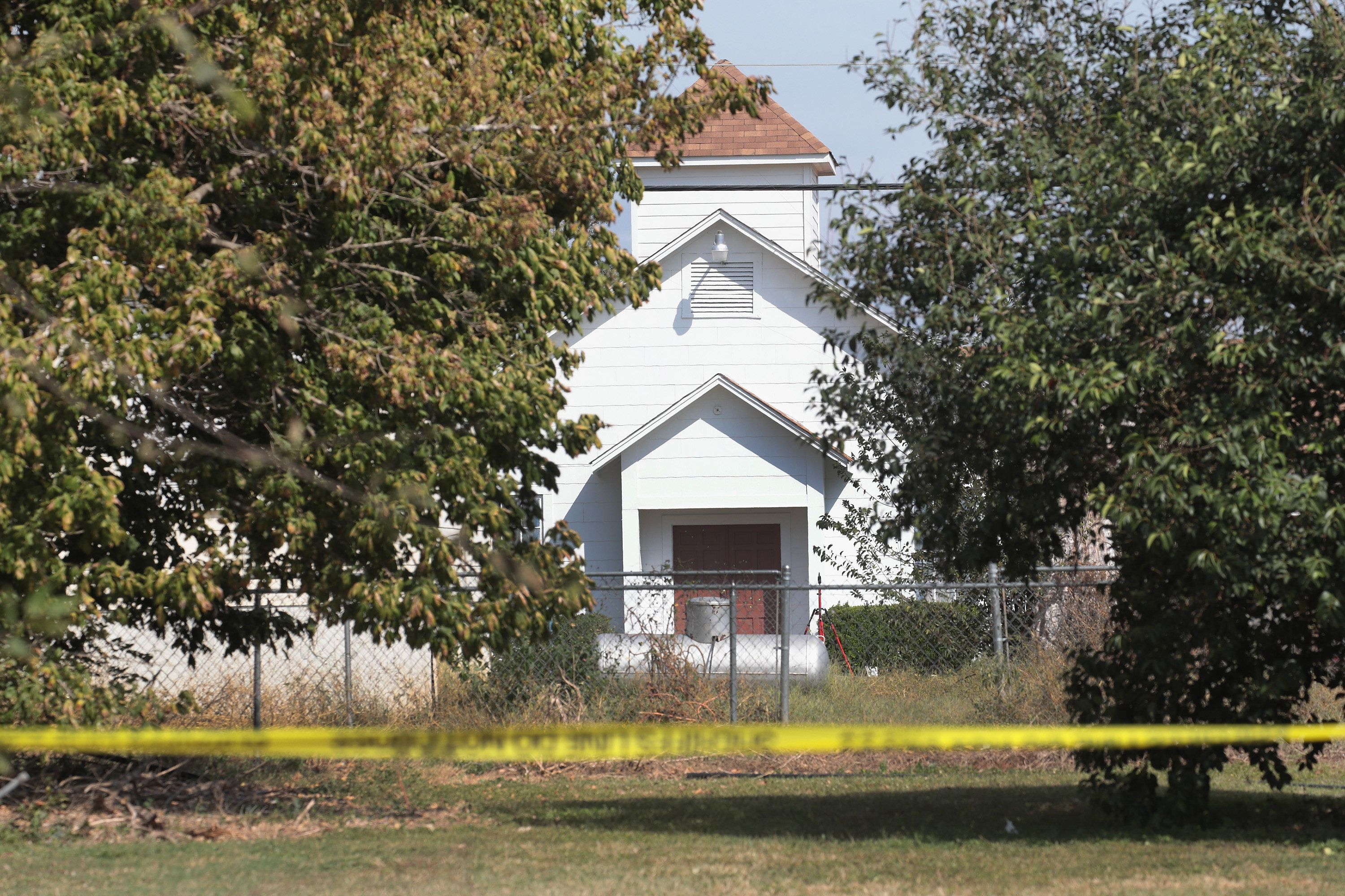 SUTHERLAND SPRINGS, TX - NOVEMBER 07:  Crime scene tape remains stretched along a road near the First Baptist Church of Sutherland Springs on November 7, 2017 in Sutherland Springs, Texas. On November 5 a gunman, Devin Patrick Kelley, killed 26 people at the church and wounded 20 more when he opened fire during a Sunday service.  (Photo by Scott Olson/Getty Images)
