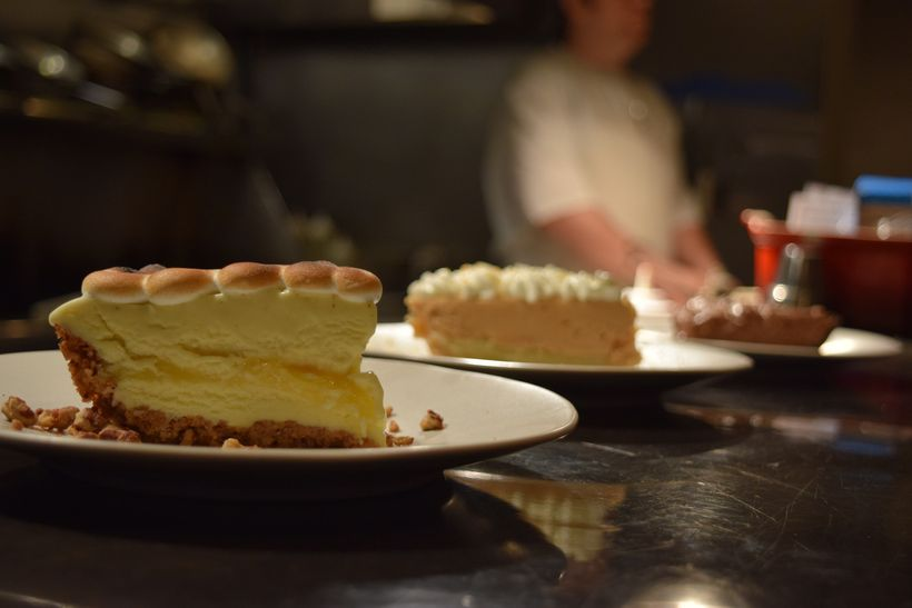 Lemon custard pie with toasted meringue and peanut butter pie with cream Chantilly
