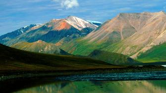 Alaska, ANWR, Franklin Mountains, Brooks Range reflected in Schrader Lake. (Photo by: Universal Images Group via Getty Images)