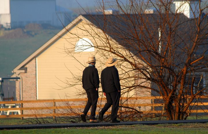 Amish men pass the newly built schoolhouse April 2, 2007 in Nickel Mines, Pennsylvania.