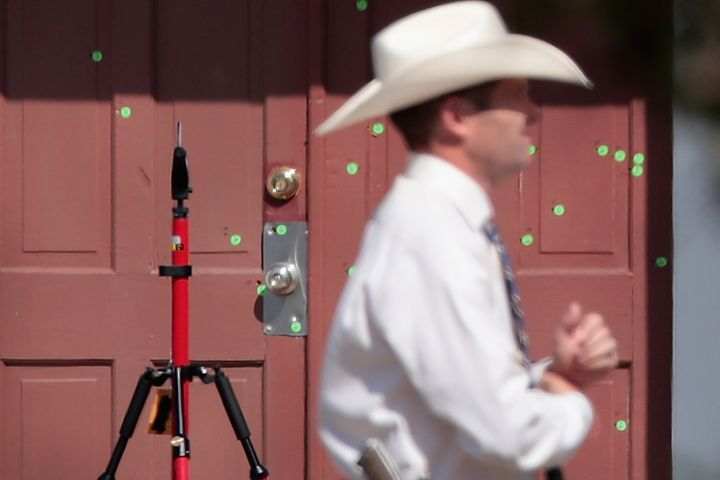 The front door of the First Baptist Church of Sutherland Springs is seen ridden with bullet holes following the Nov. 5 s