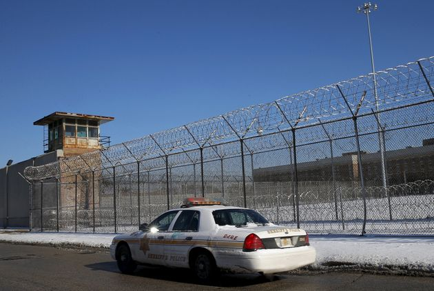 A Cook County Sheriff's police car patrols the exterior of the Cook County Jail in Chicago on Jan. 12,