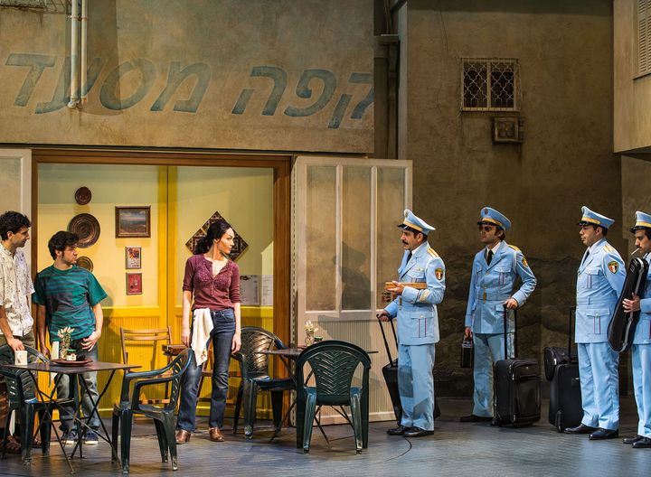 <p>Katrina Lenk and Tony Shalhoub (center) and the cast of <em>The Band's Visit</em> </p>