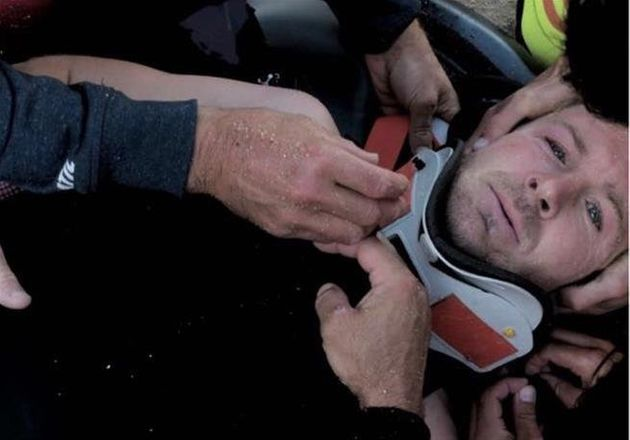 Pain shows in Andrew Cotton's eyes as he's strapped to a