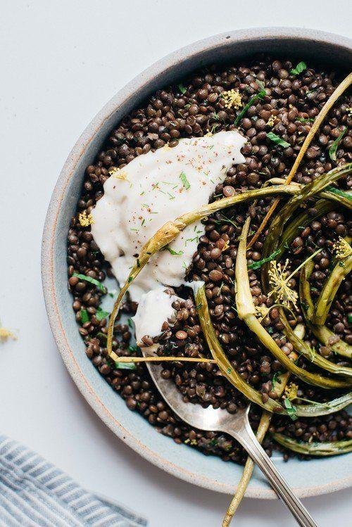 "<strong>Get the <a href=""http://www.dollyandoatmeal.com/blog/2015/6/herbed-beluga-lentils-w-garlic-scapes-yogurt-sauce"" targe"