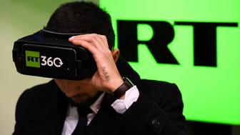 A man tries on a VR goggles at the stand of Russia's state-controlled broadcaster RT during the 10th Russian Internet Week in Moscow on November 1, 2017.  / AFP PHOTO / Kirill KUDRYAVTSEV        (Photo credit should read KIRILL KUDRYAVTSEV/AFP/Getty Images)