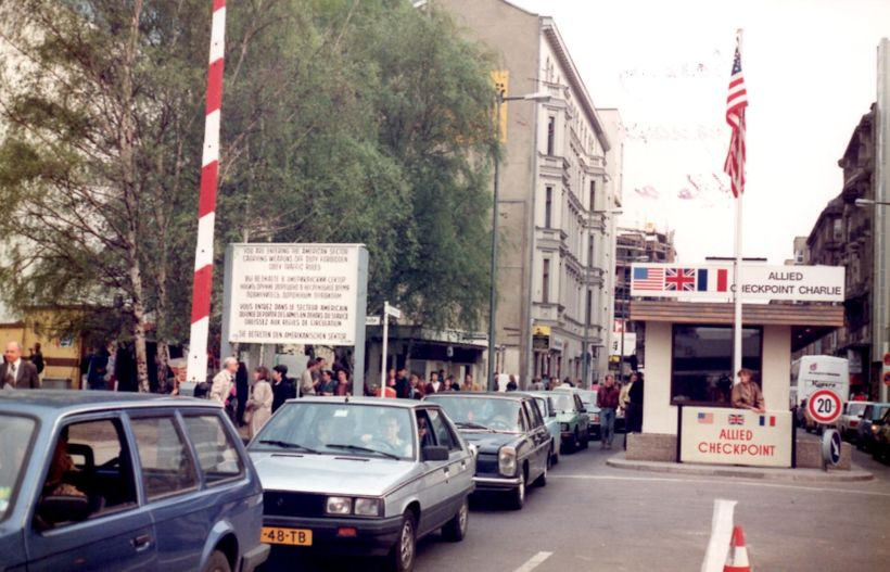 "<em>Heavy, unimpeded traffic passing through famous ""Checkpoint Charlie"" in and out of East Berlin a few weeks after the"