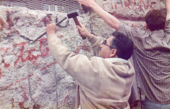 <em>Author chipping away at the Berlin Wall</em>