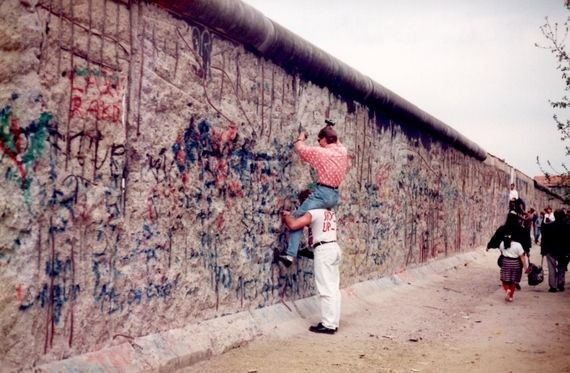 "<em>Enterprising ""hackers"" getting at ""choice pieces"" of the Berlin Wall</em>"