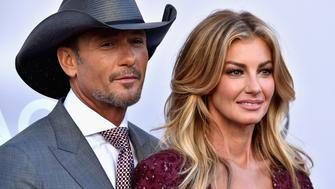 LAS VEGAS, NV - APRIL 02:  Recording artists Tim McGraw (L) and Faith Hill attend the 52nd Academy Of Country Music Awards at Toshiba Plaza on April 2, 2017 in Las Vegas, Nevada.  (Photo by Frazer Harrison/Getty Images)