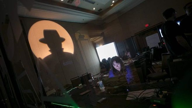 A Black Hat tech associate works during a July cybersecurity conference in Las Vegas. More than a dozen states have purchased