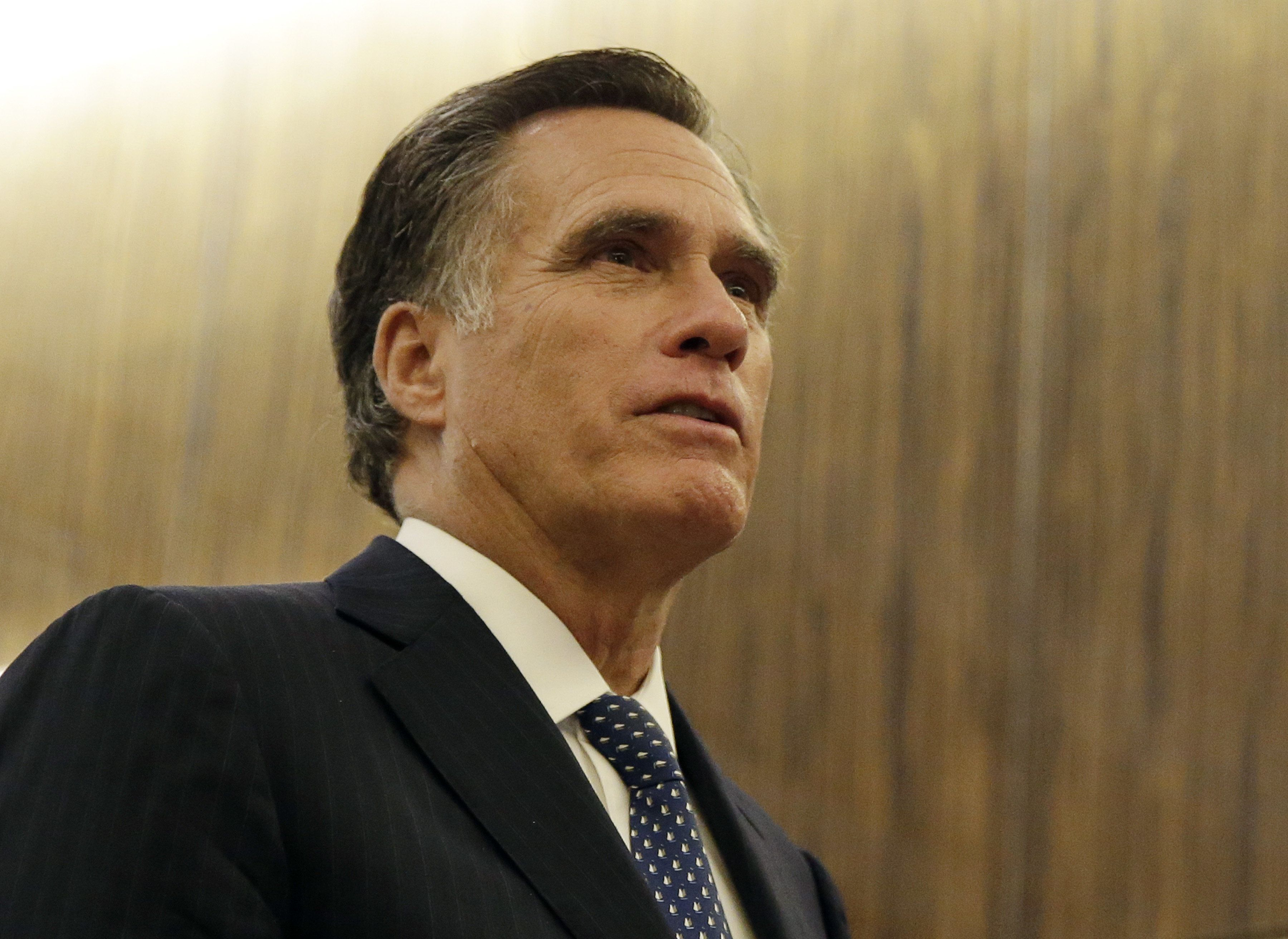 Mitt Romney, former governor of Massachusetts, reacts while speaking to members of the media after a dinner with U.S. President-elect Donald Trump at Jean Georges Restaurant in New York, U.S., on Tuesday, Nov. 29, 2016. Romney said he has increasing hope President-elect Donald Trump will lead the U.S. to a better future. Photographer: John Angelillo/Pool via Bloomberg