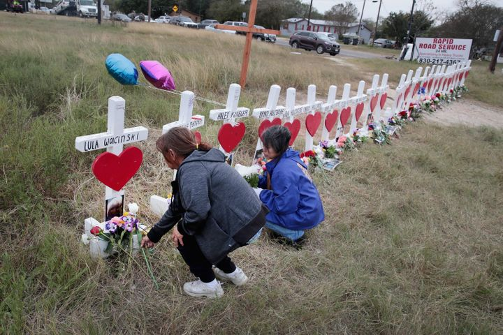 Visitors leave flowers at a memorial for the 26people killed at the First Baptist Church of Sutherland Springs.