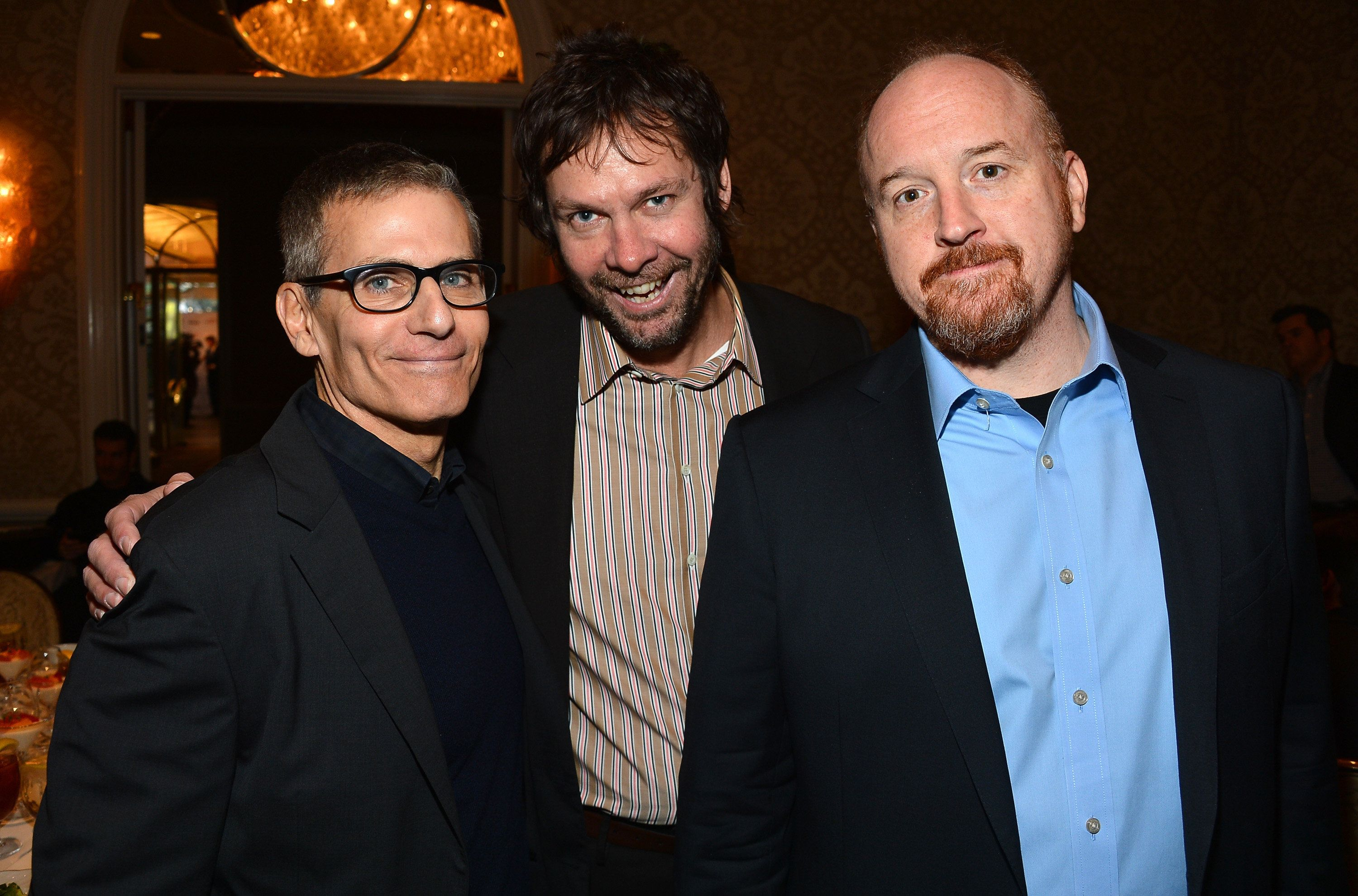 Dave Becky and Louis C.K. smile for a photo back in