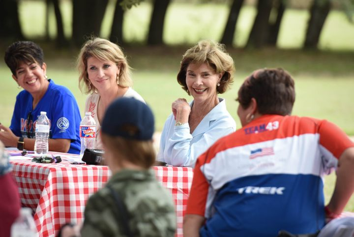 <p>Mrs. Bush speaking with family members and caregivers of veterans. </p>