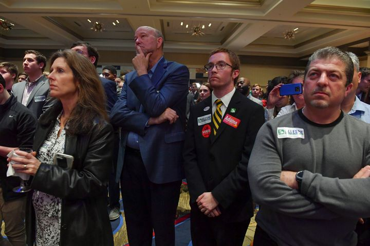 Supporters listen and look on as Virginia Republican gubernatorial candidate Ed Gillespie delivers his concession speech.