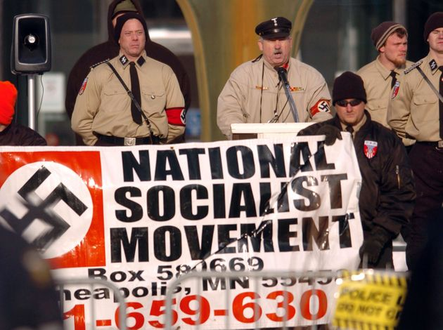 Members of the National Socialist Movement rally in downtown Toledo, Ohio, on Dec. 10,