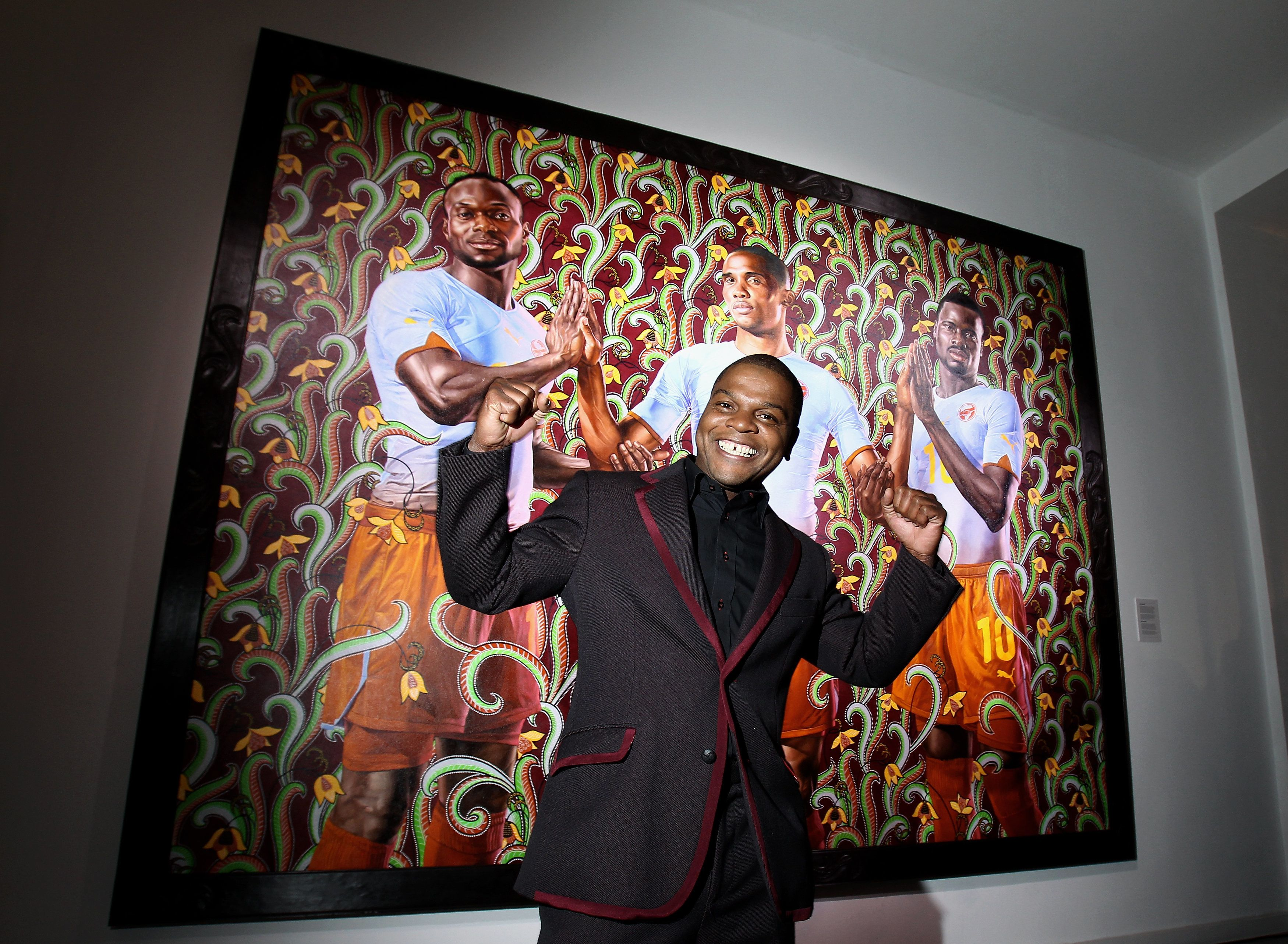BERLIN - JANUARY 20:  US artist Kehinde Wiley stands in front of his painting during the PUMA - Kehinde Wiley vernissage on January 20, 2010 in Berlin, Germany.  (Photo by Andreas Rentz/Getty Images for PUMA)