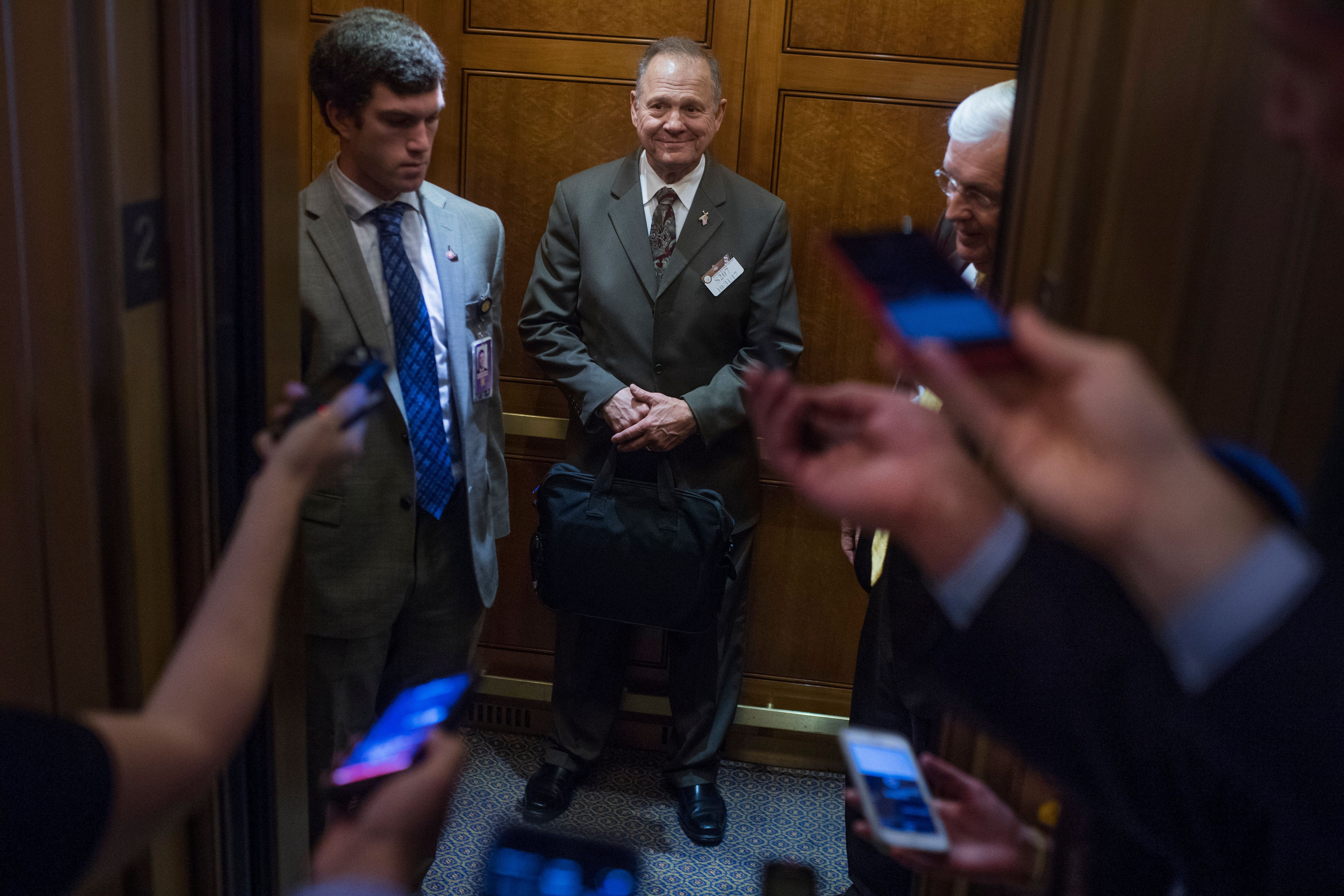 UNITED STATES - OCTOBER 31: Alabama Republican Senate nominee Roy Moore, is questioned by the media in the Capitol on October 31, 2017. (Photo By Tom Williams/CQ Roll Call)