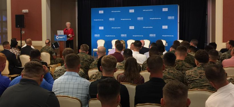 <em>Bonnie Amos speaks with transitioning service members, veterans, and military spouses at a Hiring Our Heroes event at Cam