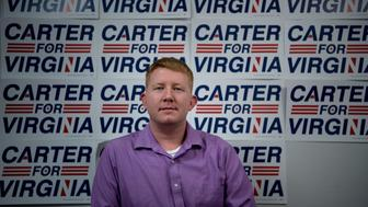 Lee Carter, a socialist who won a seat during this year's elections in the Virginia House of Delegates for the 50th District, poses on November 9, 2017 in Manassas, Virginia. / AFP PHOTO / Brendan Smialowski        (Photo credit should read BRENDAN SMIALOWSKI/AFP/Getty Images)