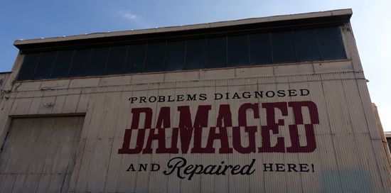 """<p>""""Damaged"""" by Shepard Fairey"""" Outside of building </p>"""