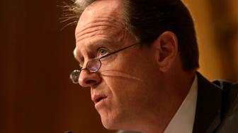 Senator Pat Toomey (R-PA) questions witnesses at the Senate Finance Committee in Washington May 21, 2013.  A Senate panel will try on Tuesday to pry more details out of current and former officials of the Internal Revenue Service about the agency's targeting of conservative groups for extra scrutiny when they sought tax-exempt status. REUTERS/Gary Cameron  (UNITED STATES - Tags: POLITICS BUSINESS)