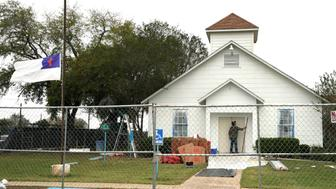 A worker installs new doors at the site of the shooting at the First Baptist Church of Sutherland Springs, Texas, U.S. November 9, 2017. REUTERS/Rick Wilking