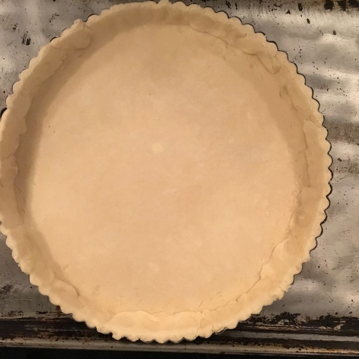 <p>Pastry-lined tart pan, patched where necessary around the edges</p>