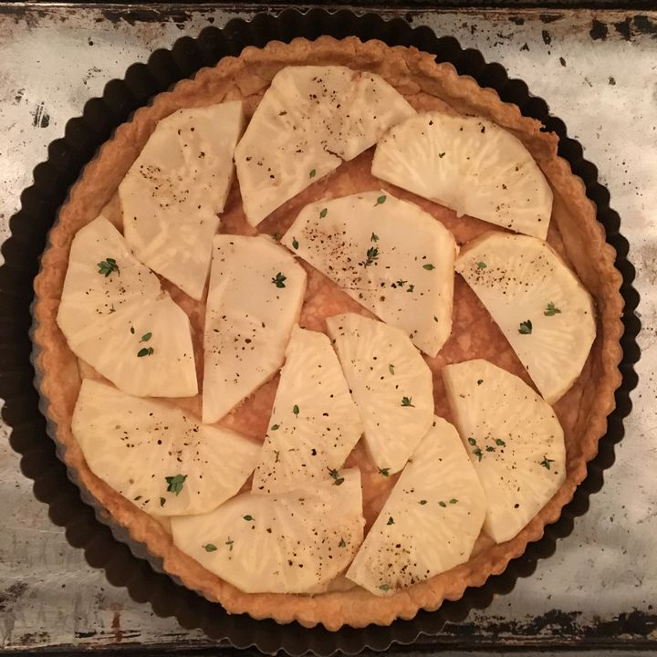 <p>A layer of cooked celery root slices, well seasoned</p>