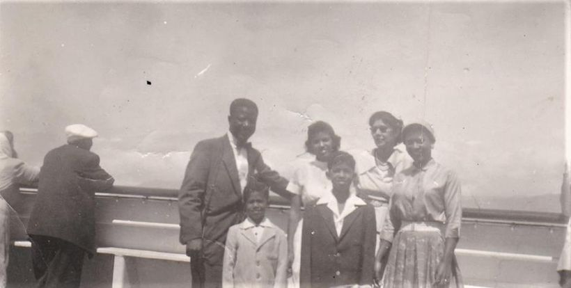 Smallwood (center) with family on the SS Constitution somewhere on the Atlantic, 1955.