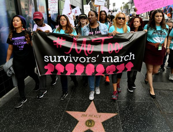 Tarana Burke (center), originator of the #MeToo campaign, leads marchers.