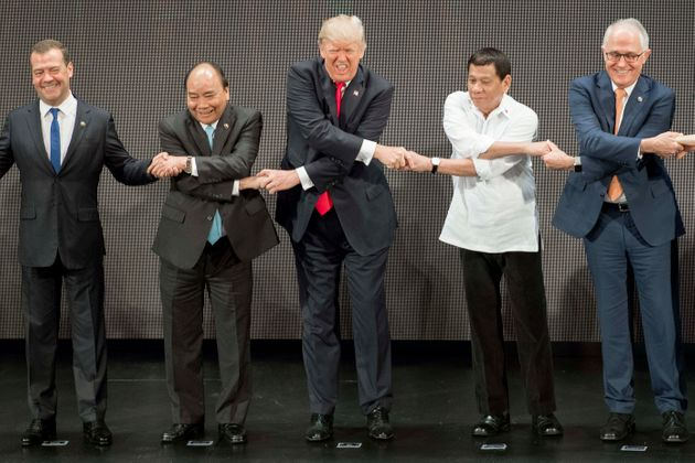 Trump's ASEAN Summit Handshake May Be His Most Ridiculous